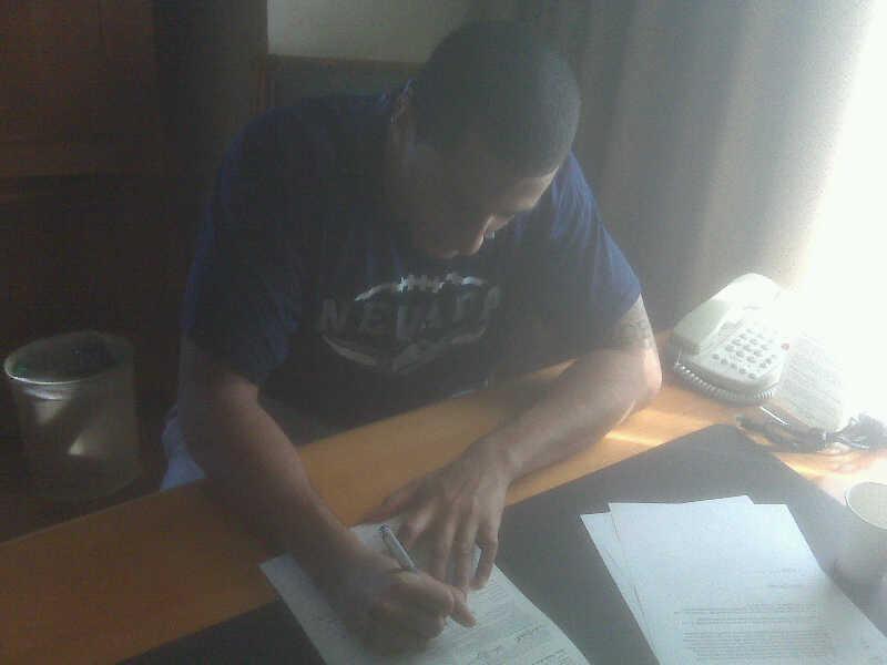 Page 27_Kaepernick_signing.jpg