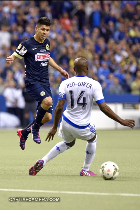 Montreal, Canada - April 29, 2015: Oribe Peralta #24 of Club America jumps to avoid Nigel Reo-Coker #14 of Montreal Impact.
