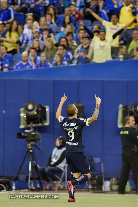 Montreal, Canada - April 29, 2015: Dario Benedetto #9 of Club America scores his third goal of the game to seal a hat-trick.
