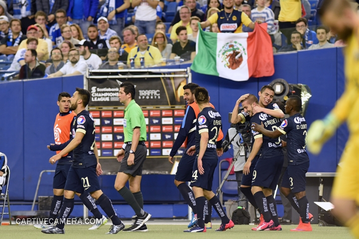 Montreal, Canada - April 29, 2015: Club America players celebrate Dario Benedetto's hat trick while Montreal Impact goalie Kristian Nicht is unsettled.