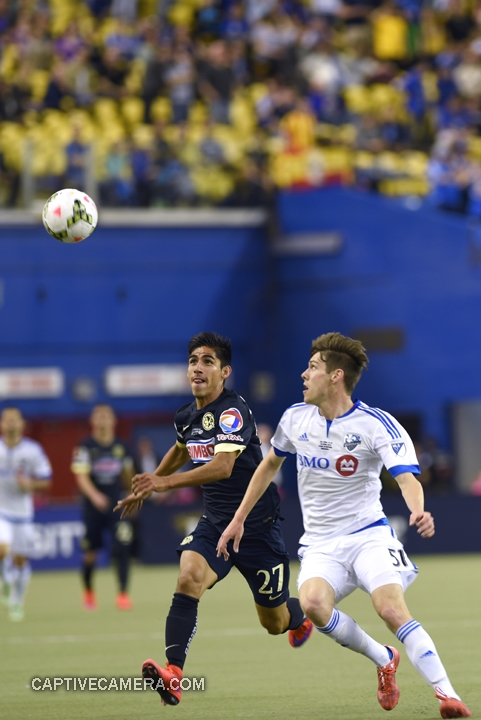 Montreal, Canada - April 29, 2015: Jose Maduena #27 of Club America and Maxim Tissot #51 of Montreal Impact fight to win possession of the ball.