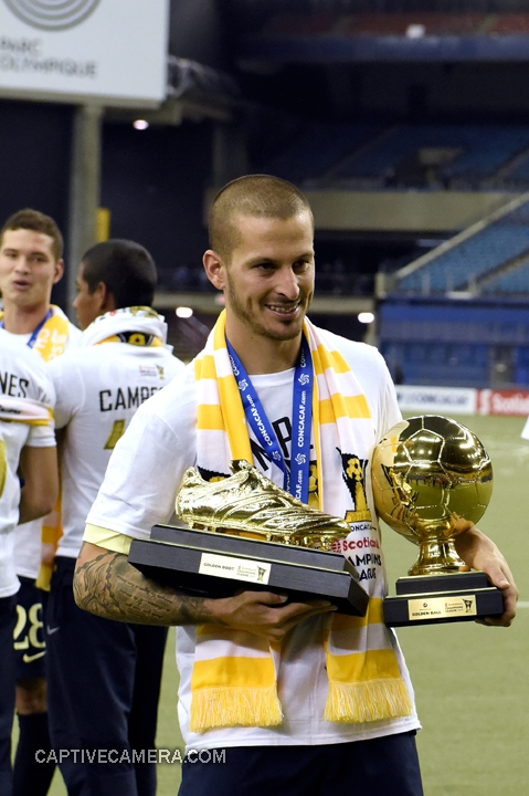 Montreal, Canada - April 29, 2015: Dario Benedetto of Club America displays the tournament Golden Boot and Golden Ball.
