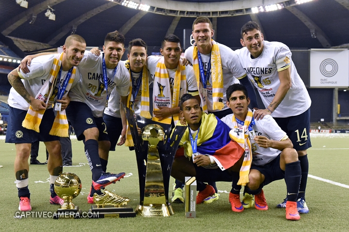 Montreal, Canada - April 29, 2015: Club America players pose with medals and trophies at Montreal's Olympic stadium.