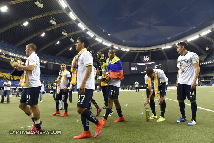 Montreal, Canada - April 29, 2015: Michael Arroyo and Club America teammates carry the Scotiabank CONCACAF Champions League trophy.