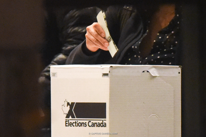 Oct. 19. 2015 (Toronto, ON) - A voter submits their ballot during Canadian federal elections.