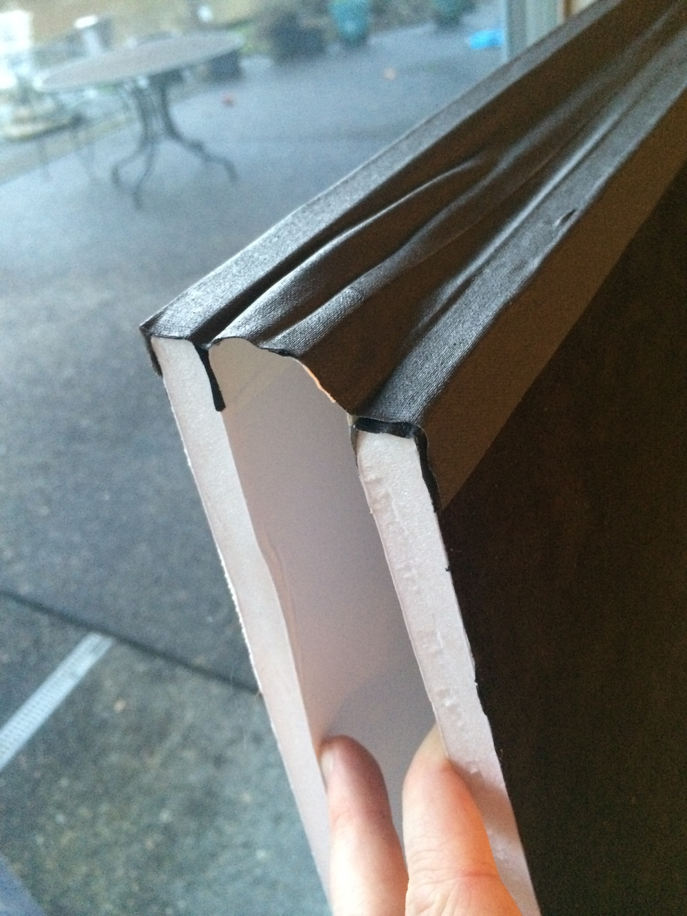 This is what it looks like after. My tape was wide enough to cover the hinge in just two pieces, but use three if necessary.