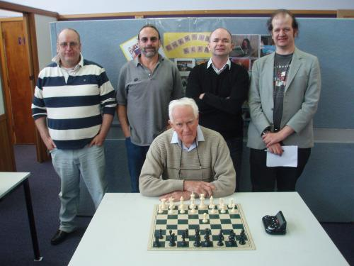 Neville Ledger (seated) in a photo of present and former Tasmanian Champions taken in 2012. Ledger was Tasmanian Champion in 1965. (The others are (l to r) Nigel Frame, Neil Markovitz, Tony Dowden and Kevin Bonham).