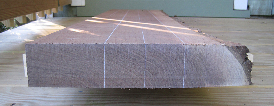 End grain view of a walnut board showing rift sawn grain orientation for rear legs