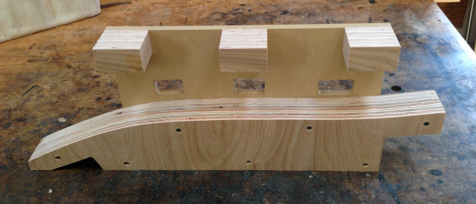 The slat mortise jig showing the template, backstop, and three supports