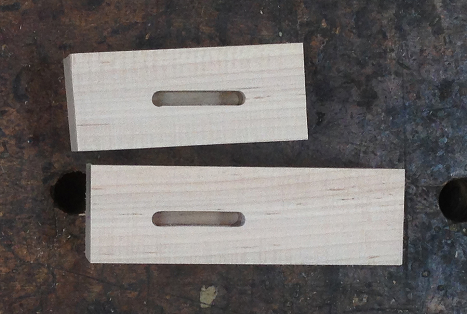"The top mortise has a small defect on the bottom left corner. Using an initial 1/16"" plunge corrects that, as shown on the bottom mortise"
