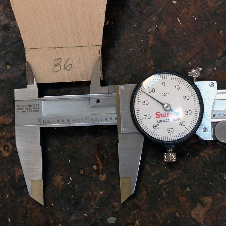 Fitting the slat tenons: After shaping the bottom edge, use the dial calipers to mark for the top edge