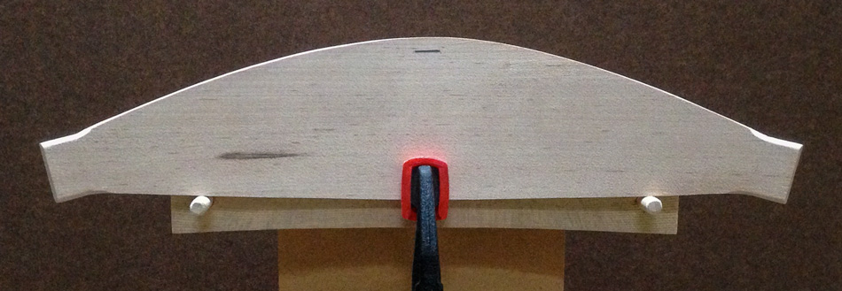 "Shaping the slats: The top edge is ready to bevel. I've placed a reference mark 5-16"" from the top."