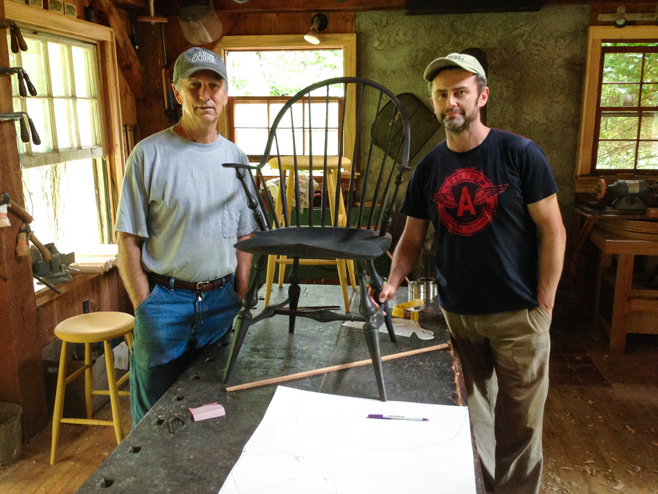 Curtis Buchanan (left) and Glen Rundell inside Curtis' shop