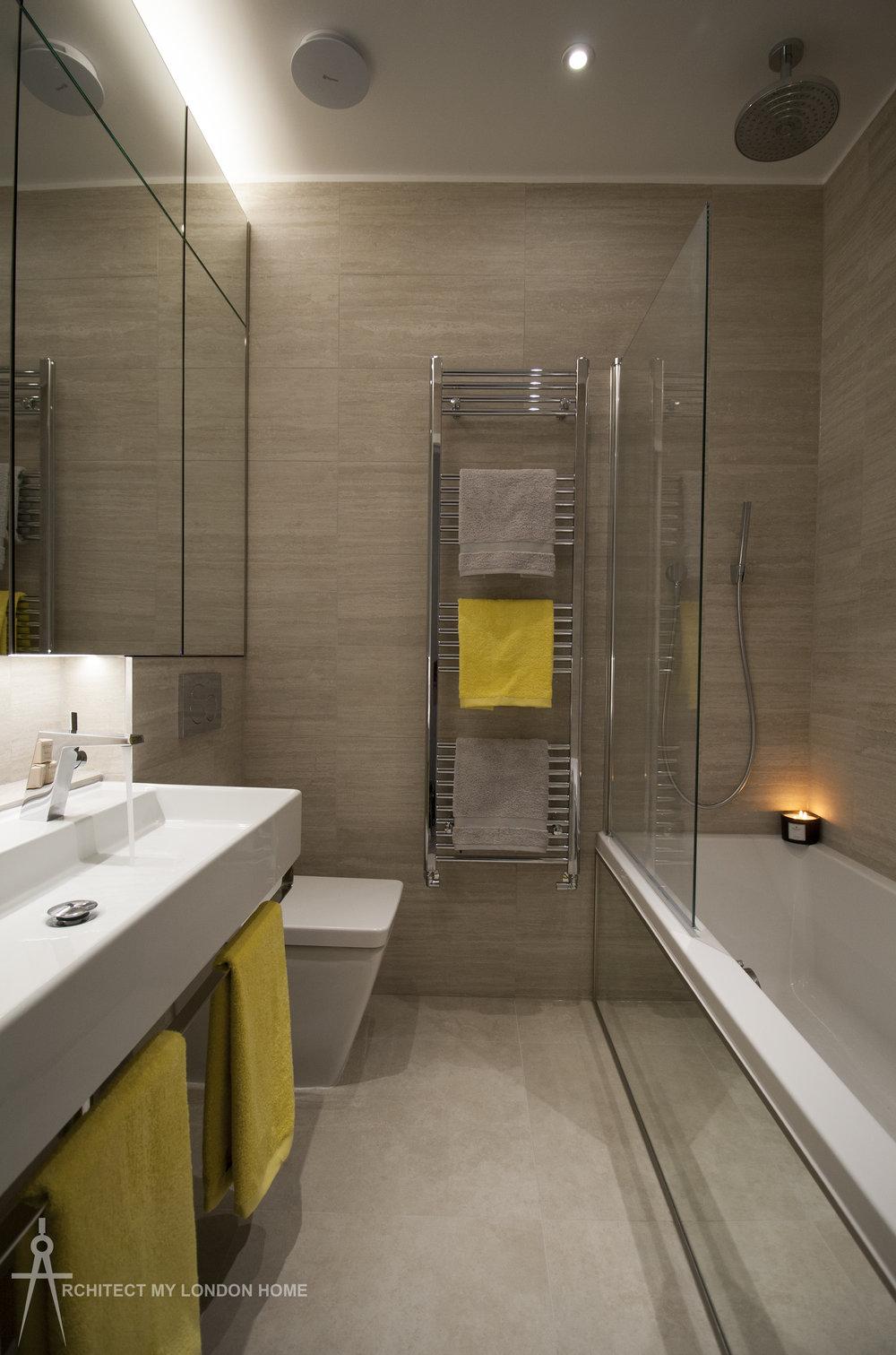 Mood lighting and mirrored bath panel