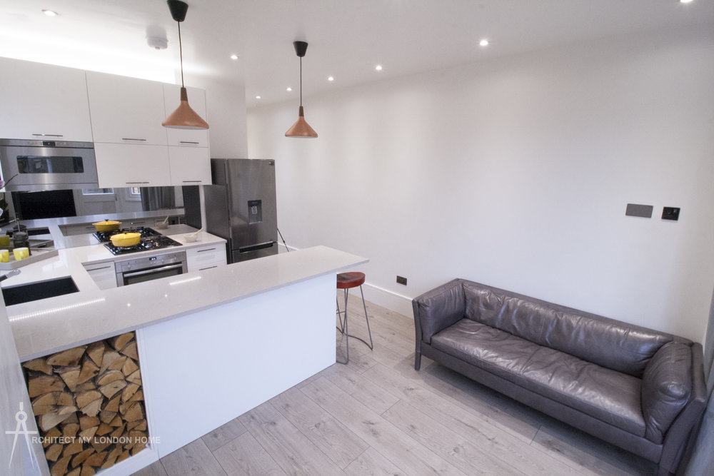 Open plan Living and Kitchen with mood-lighting options and mirrored splashback. Real wood / Multi-fuel stove in the living area