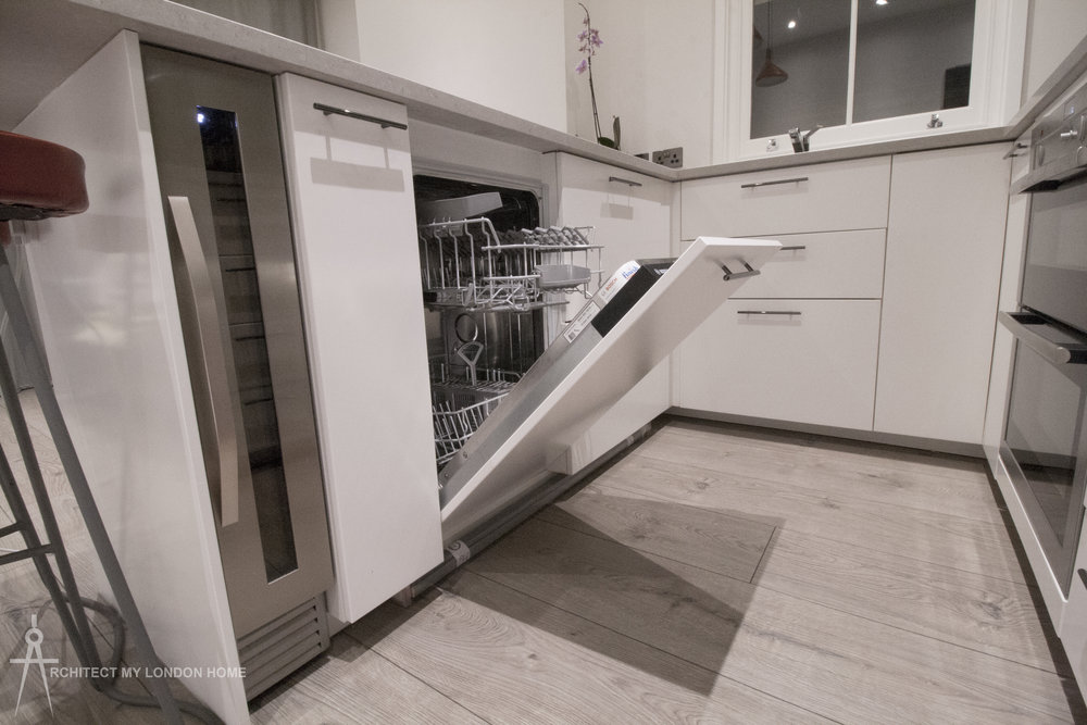 In-built wine fridge, dishwasher, double oven, gas hob, extractor fan and microwave. Free-standing fridge freezer