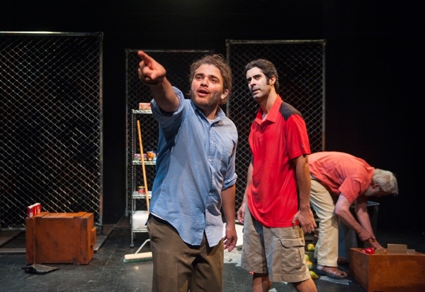 Ali (Abdulrahim Harara, left) speaks to Khoresh (Damien Seperi, center) as Abu Omar (Julian Lopez-Morillas) cleans his store after a bomb goes off outside in Emma Goldman-Sherman's   Counting in Sha'ab  , directed by Erin Gilley.