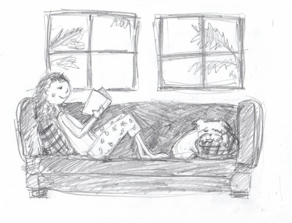 Liz curled up on the couch with her pup.