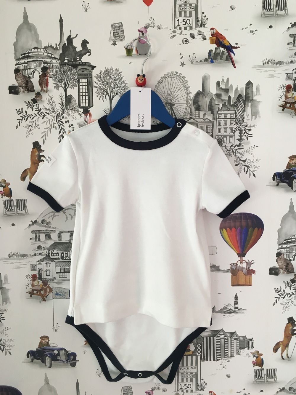 White with Navy edge   from  £13  sizes 3-4yrs/5-6yrs/7-8yrs/9-10yrs