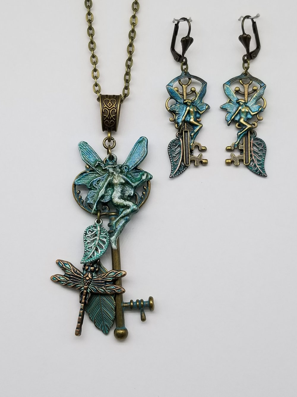 Karizma  Distress Painted and Patina'd Fairy Pendant with Earrings.jpg