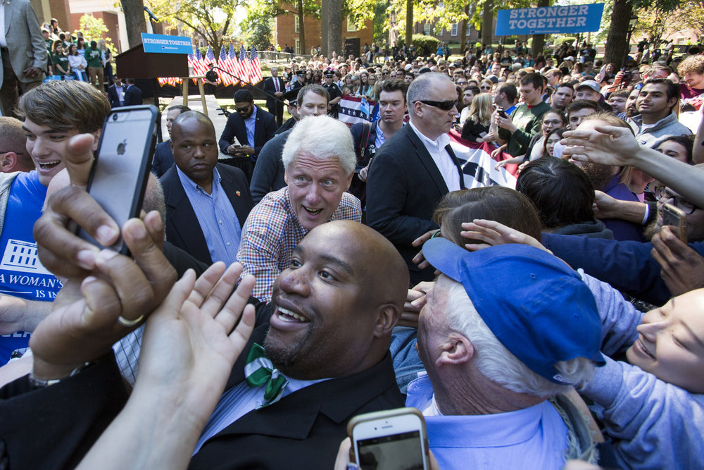 Former president Bill Clinton shakes hands and takes selfies with students and Athens residents after speaking on College Green on October 4, 2016.