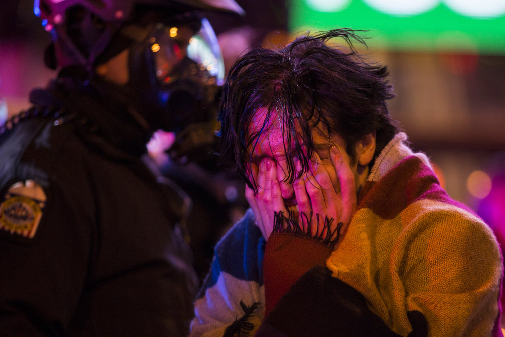 "Connor Lefevers rubs his eyes and yells after being pepper sprayed by police for not clearing the streets during a ""Resist Trump Rally"" in Columbus, Ohio in response to President Trump's executive order on immigration on January 30, 2017."