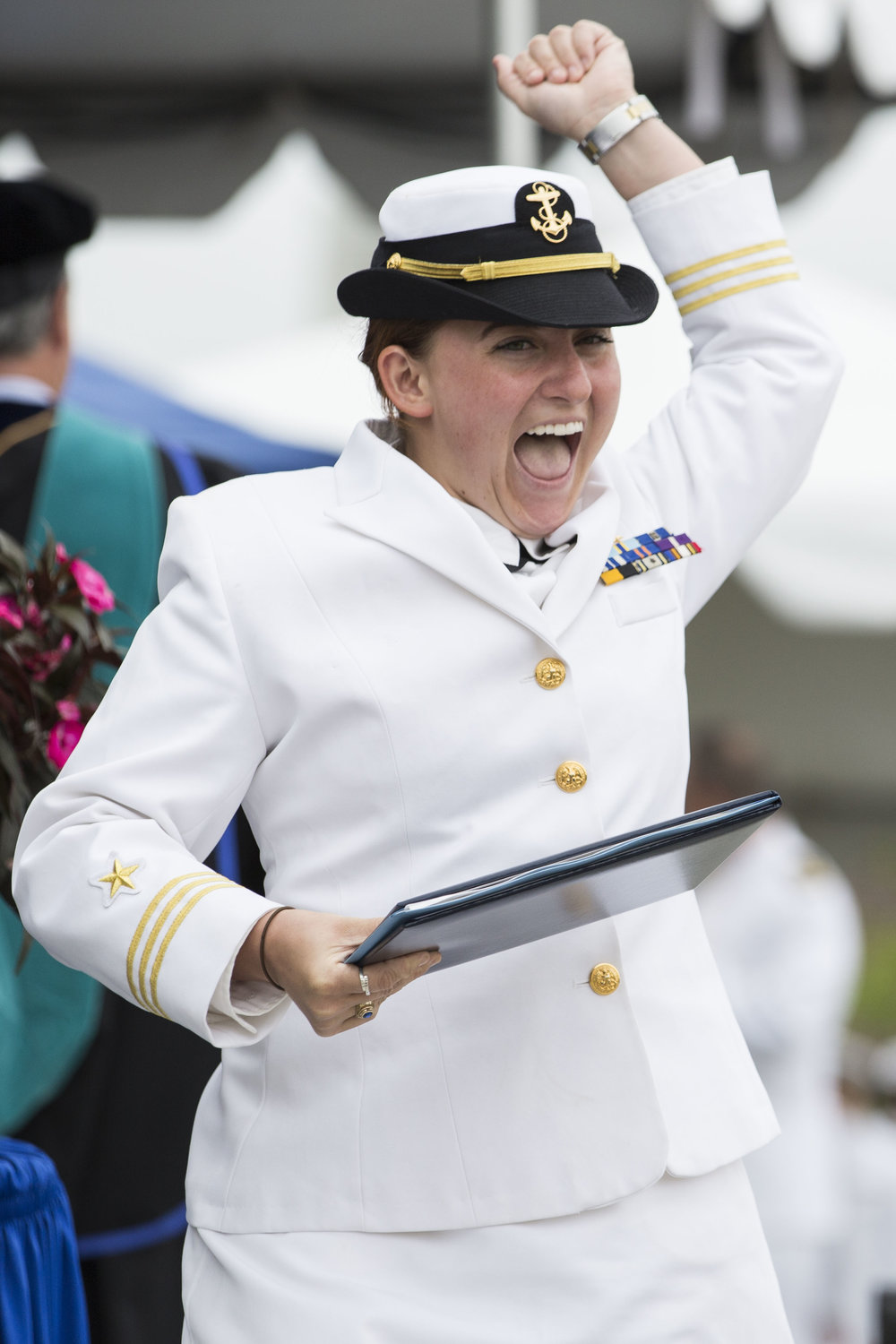 Natalie Lu celebrates after accepting her diploma during the Massachusetts Maritime Academy Commencement ceremony on June 17, 2017.