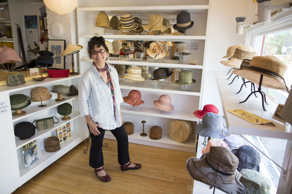 Lisa Ventre of Lisa Ventre Hats in Provincetown poses for a portrait in her shop on June 13, 2017.