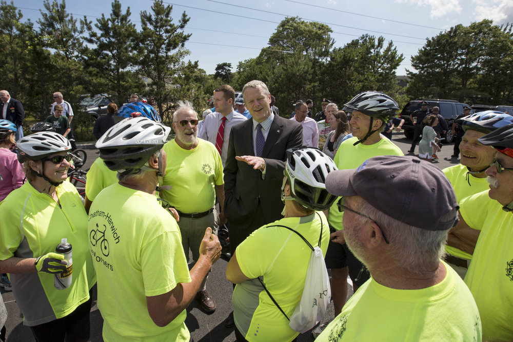 Governor Charlie Baker talks with members of the Chatham-Harwich Newcomers club at the opening of the extension to the Cape Cod Rail Trail in South Dennis off of route 134 on June 28, 2017.