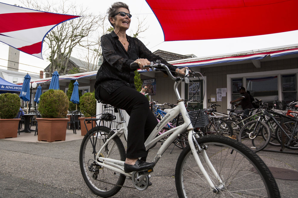 Kate Clinton arrives on her bike at Crown and Anchor for her stand-up comic gig in Provincetown, Massachusetts on July 1, 2017.