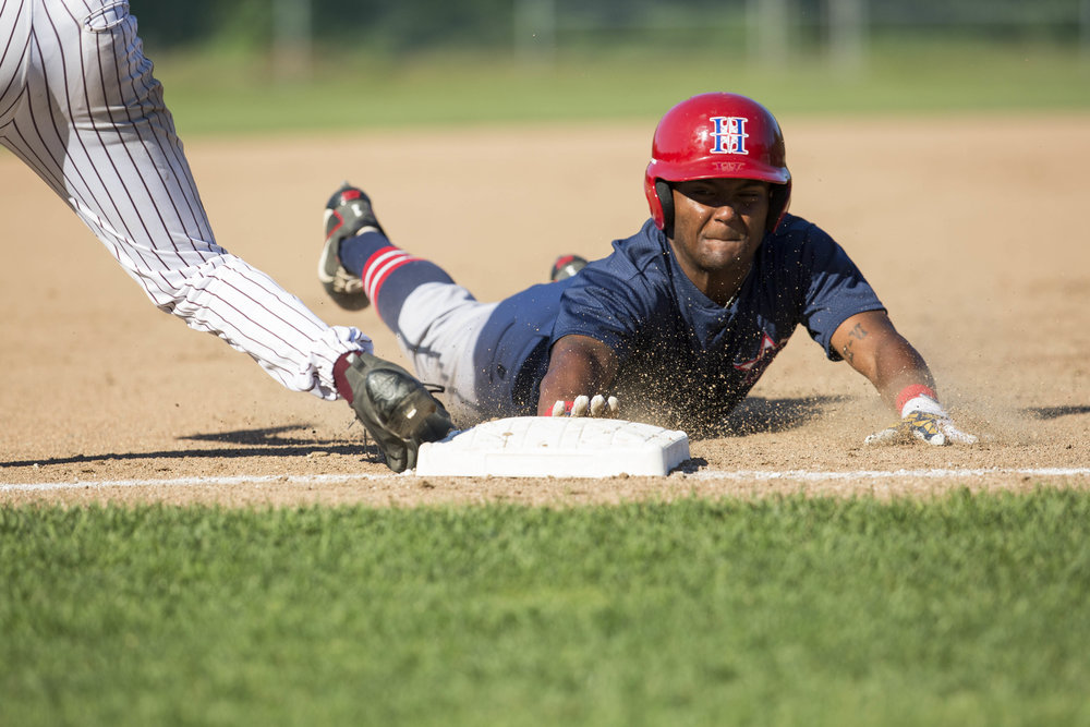 Cobie Vance, of the Harwich Mariners, slides to third base and was called safe during their game against the Cotuit Kettleers on July 9, 2017.