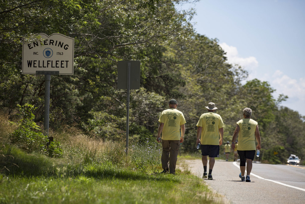 Jay Coburn, Liam Cahill and Richard Waystack walk along route 6 during the Housing with Love Walk on July 10, 2017. This is a seven-day walk spanning the length of Cape Cod, from Provincetown to Falmouth.