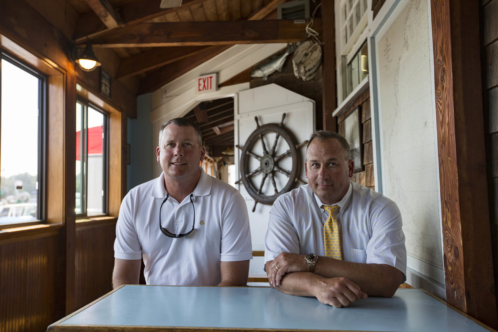 Sam and Ben Baxter pose for a portrait inside Baxter's Fish 'N Chips on July 11, 2017. Baxter's is celebrating it's 50th season this year.