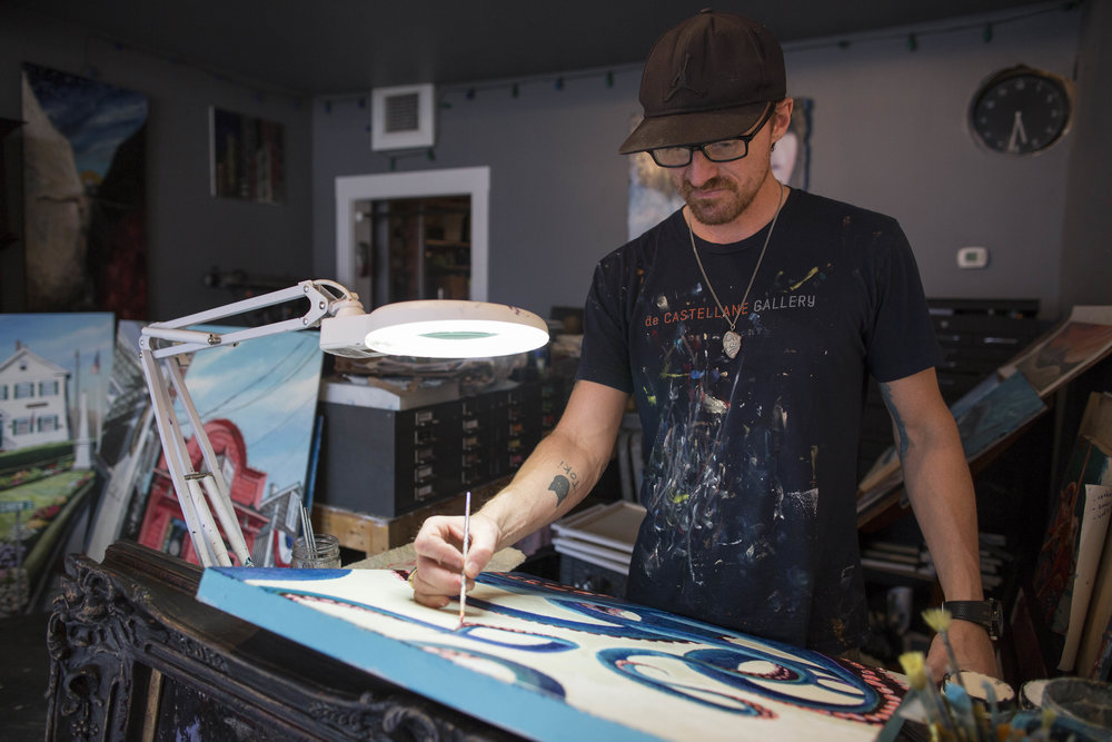 Hans de Castellane works on a piece in his studio on Main Street in Dennis Port on July 15, 2017. The Dennis Port Revitalization Committee has asked de Castellane to paint a third mural in downtown Dennis Port.