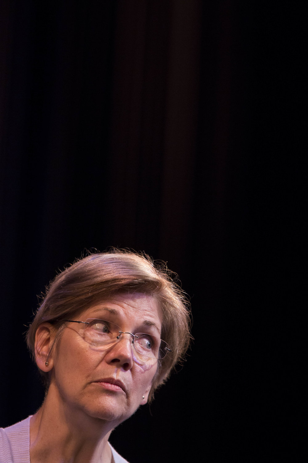 Senator Elizabeth Warren answers questions from the audience at the town hall-style meeting in the Tilden Arts Center at Cape Cod Community College on July 16, 2017.