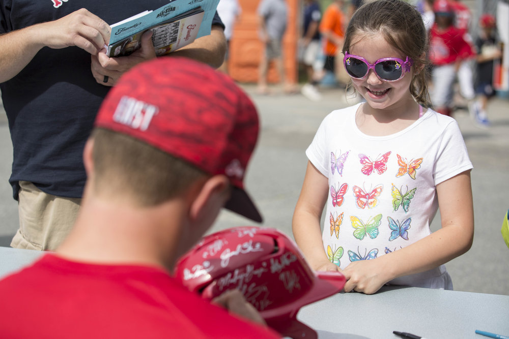 Julianna Ware, 8, gets a helmet signed by Cape League Baseball players before the start of the All Star Game on July 22, 2017.