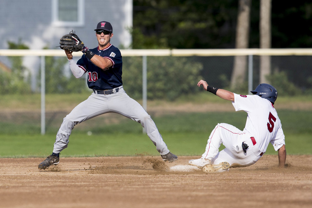 Carter Pharis slides to second as Jarren Duran attempts to get him out during the Yarmouth-Dennis Red Sox home game against the Wareham Gatemen on July 23, 2017. Pharis was called safe at second.