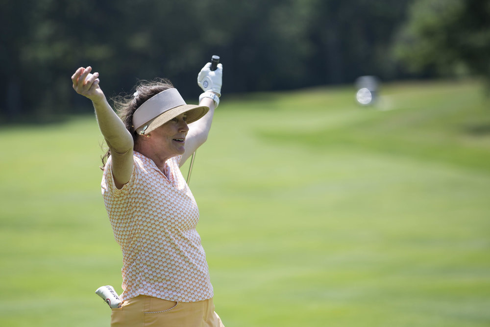 Elizabeth Buckner cheers as her friends finishing the ninth hole at Willowbend Country Club on August 2, 2017