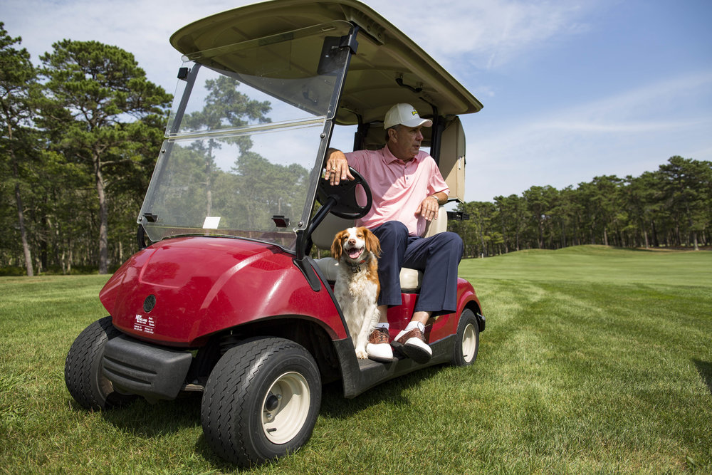 "James ""Jim"" Armentrout, the Golf Director at Bayberry Hills Golf Course, points out the new renovations to the course while his dog Scout, a 7-year-old Brittany, rides along in the golf cart on August 2, 2017."