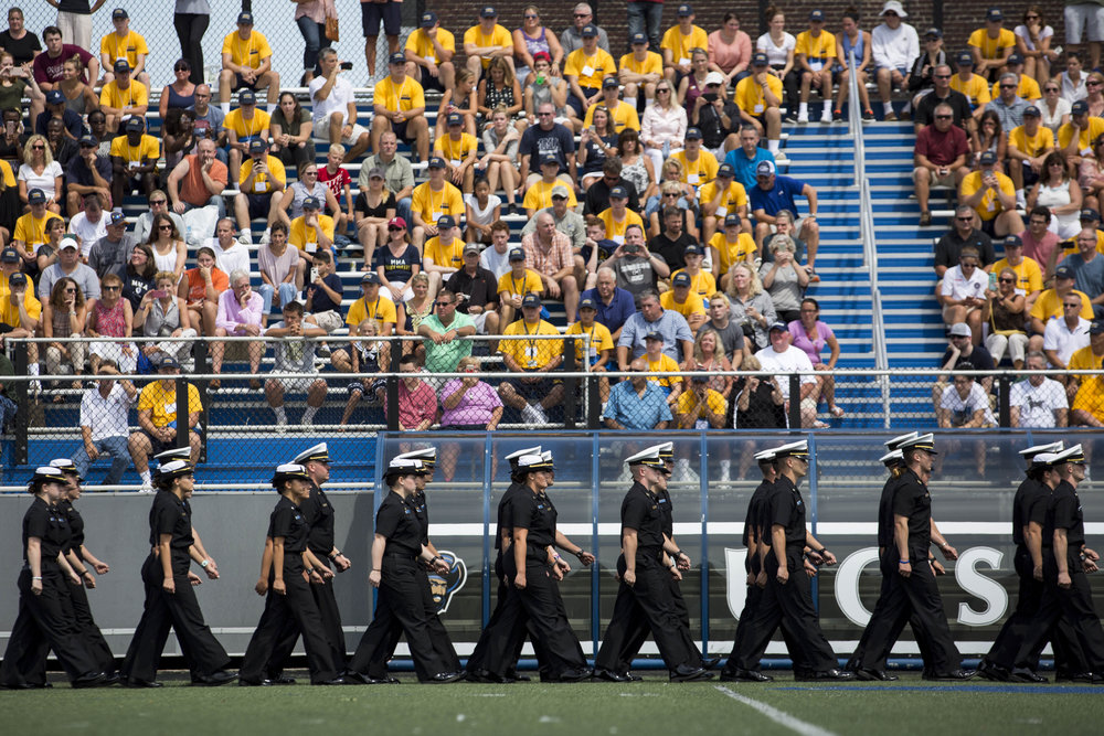 Current Mass Maritime Academy students march on the field during freshman orientation on August 19, 2017.