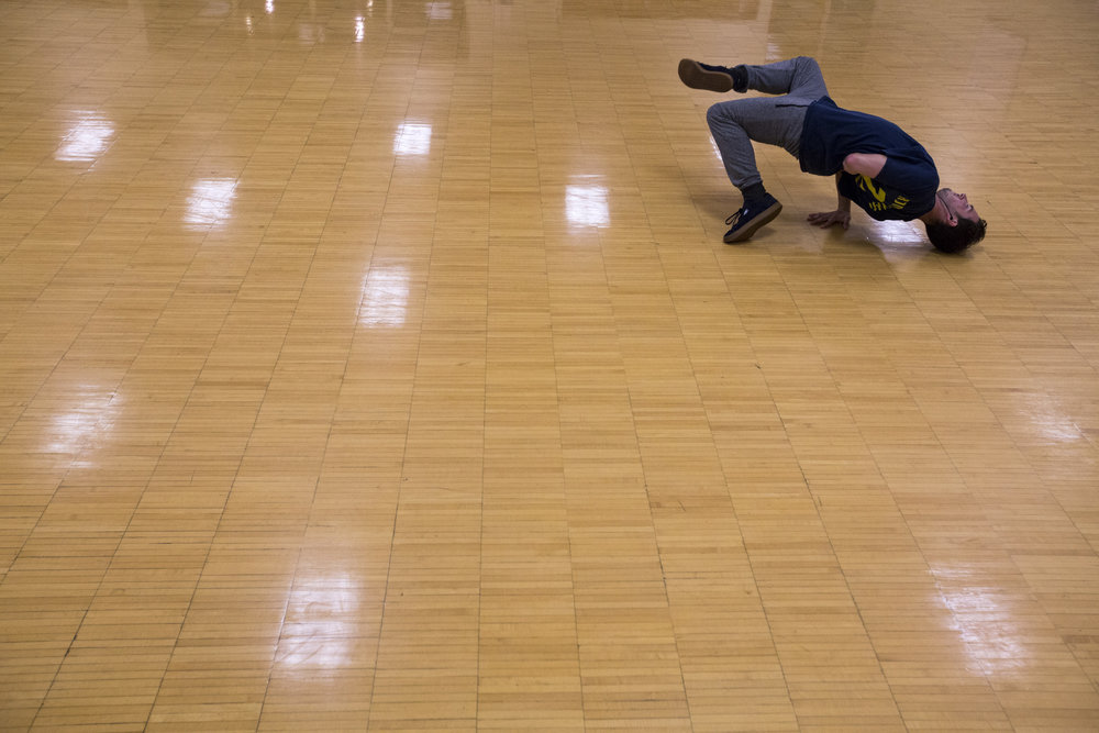 Seth Baker practices break-dancing in an empty room in Ping Center on September 18, 2017.