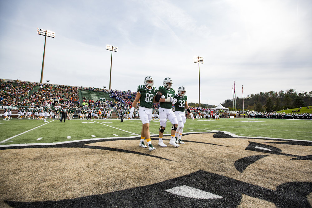 Ohio Football team captains walk to the middle of their field for the coin toss before the start of the Ohio vs Kent game on October 21, 2017. Ohio beat Kent State 48-3.