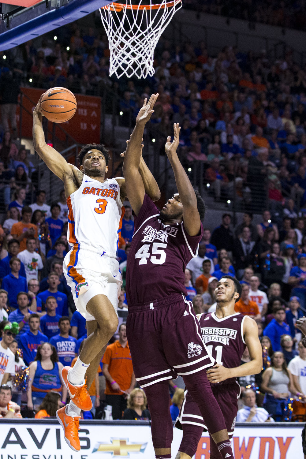 Florida Gator Jalen Hudson (3) goes in for a layup as Mississippi State's E.J. Datcher attempts to block him during the Florida vs Mississippi State game on January 20, 2018. The Gators beat the Bulldogs 71-54.