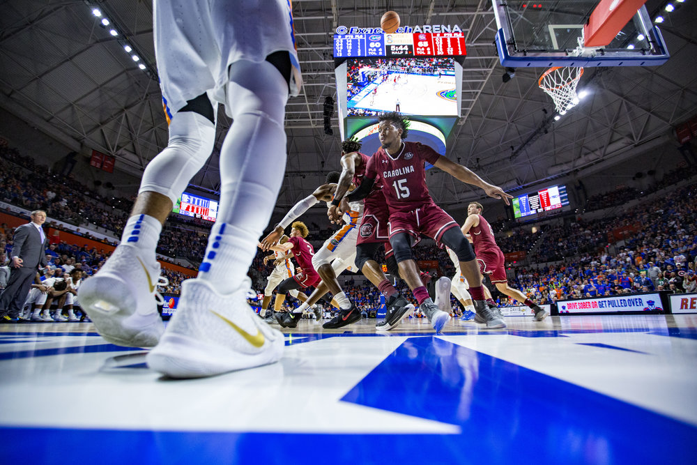 Florida guard Chris Chiozza throws the ball over multiple South Carolina players during the Florida vs South Carolina game on January 24, 2018. The Florida Gators lost 72-77 to the South Carolina Gamecocks.