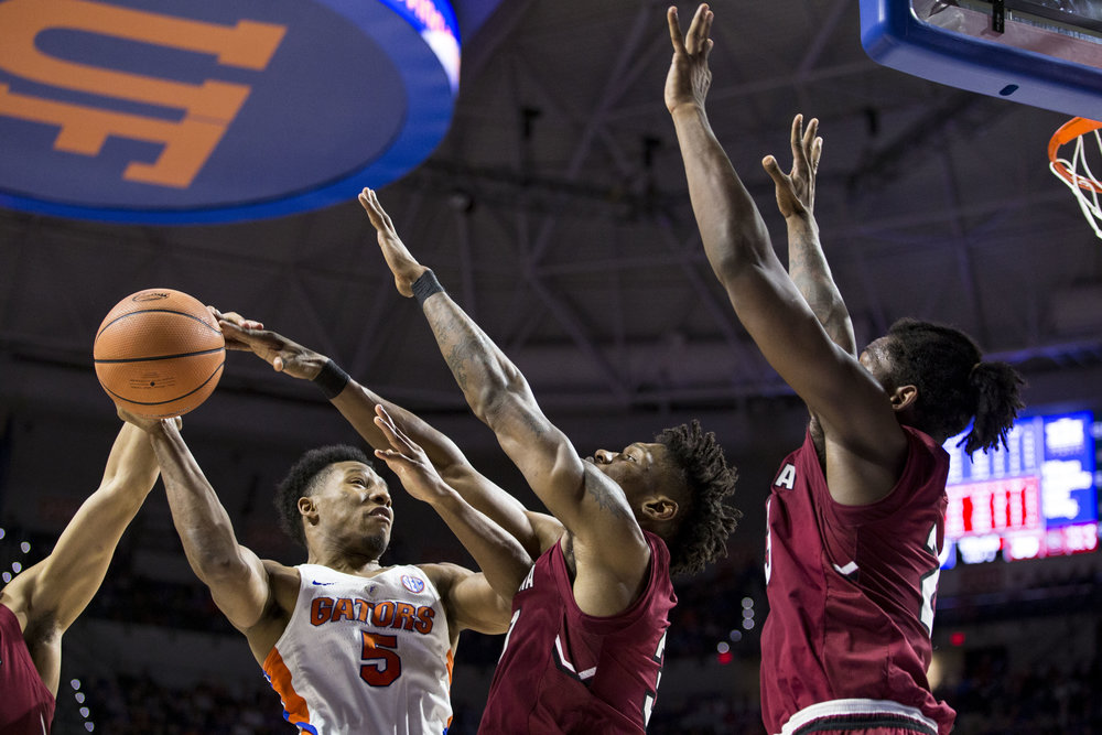 Florida guard KeVaughn Allen attempts to score over two South Carolina players during the Florida vs South Carolina game on January 24, 2018. The Florida Gators lost 72-77 to the South Carolina Gamecocks.