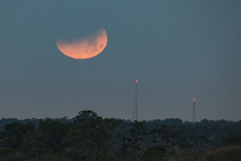 The Super Blue Blood Moon sets over Gainesville on January 31, 2018.