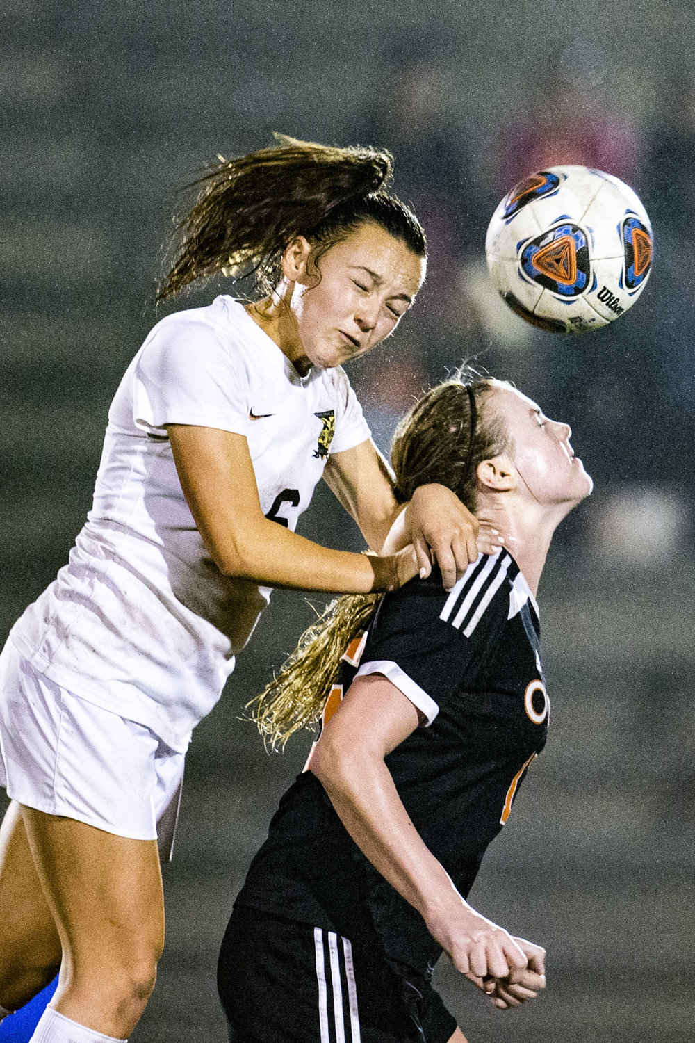 Buchholz's Natalie Johnson pushes off of an Oviedo player to head the ball during the match at Citizens Field on February 13, 2018. Buchholz High lost 0-2 to Oviedo High.