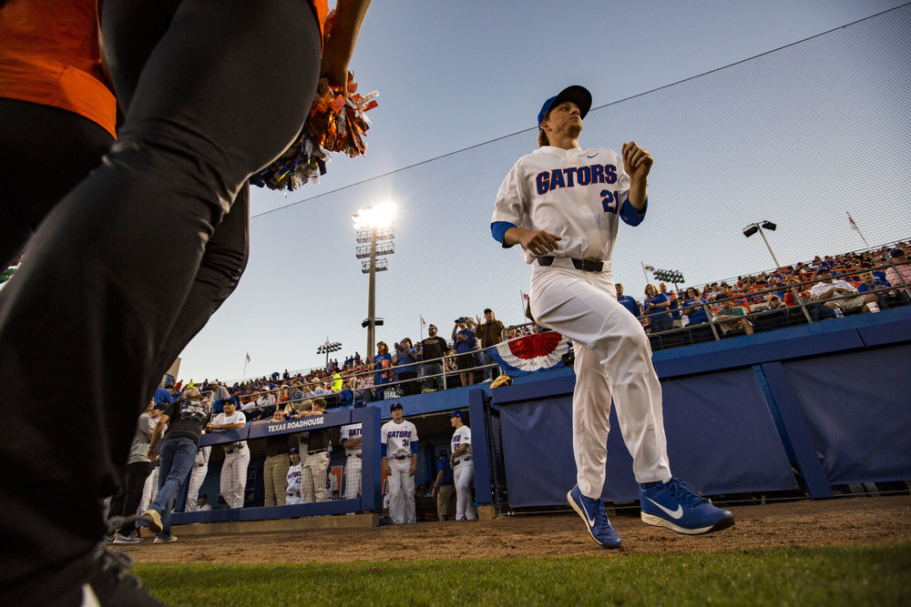 Florida Gators Nick Blasucci runs out onto the field after his name is announced before the start of Florida's home opener against the Siena Saints on February 16, 2018. The Florida Gators beat the Siena Saints 7-1.