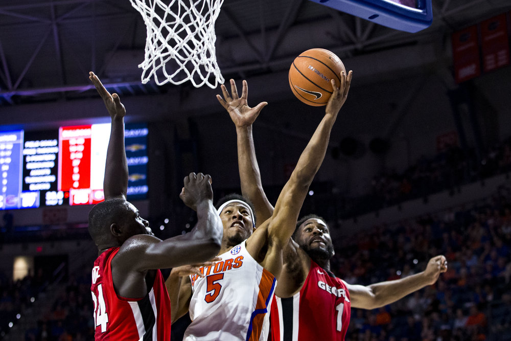 Florida Gators guard KeVaughn Allen attempts to score between two Georgia Bulldogs as the Florida Gators take on the Georgia Bulldogs in the Stephen C. O'Connell Center on the University of Florida campus in Gainesville, Florida on Wednesday February 14, 2018.