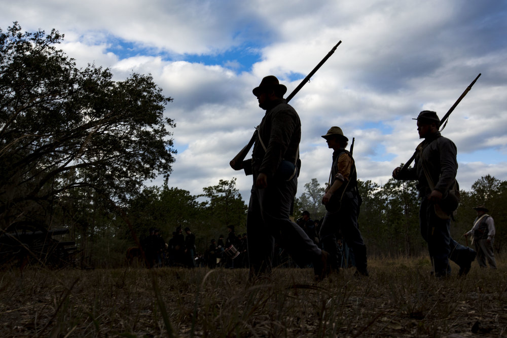 Soldiers walk back to their camp after the Battle of Olustee re-enactment on February 17, 2018.